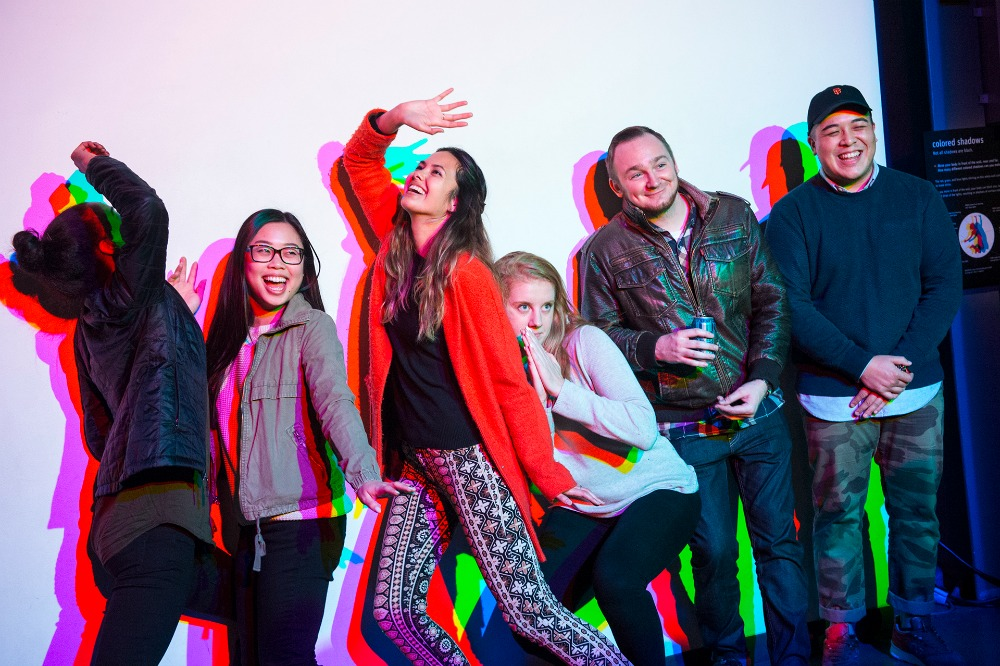 02_AfterDark - visitors pose in front of colored shadows Exploratorium