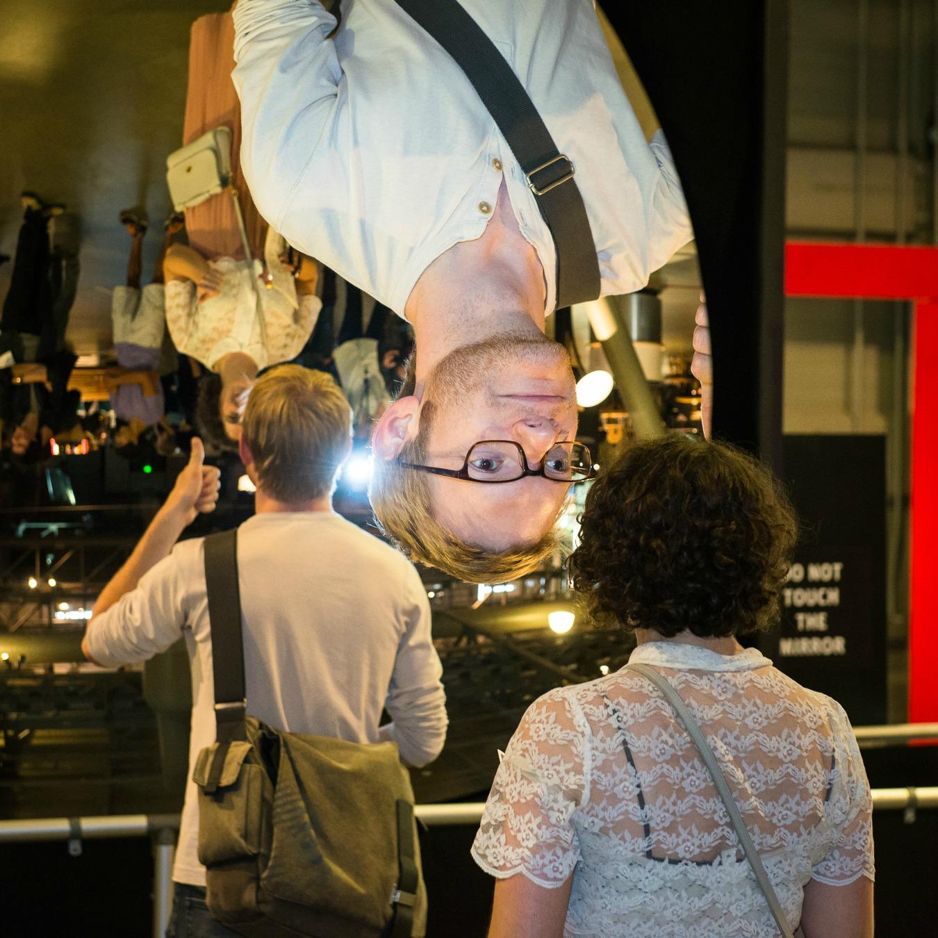 05_AfterDark - visitor explores a giant mirror at Exploratorium
