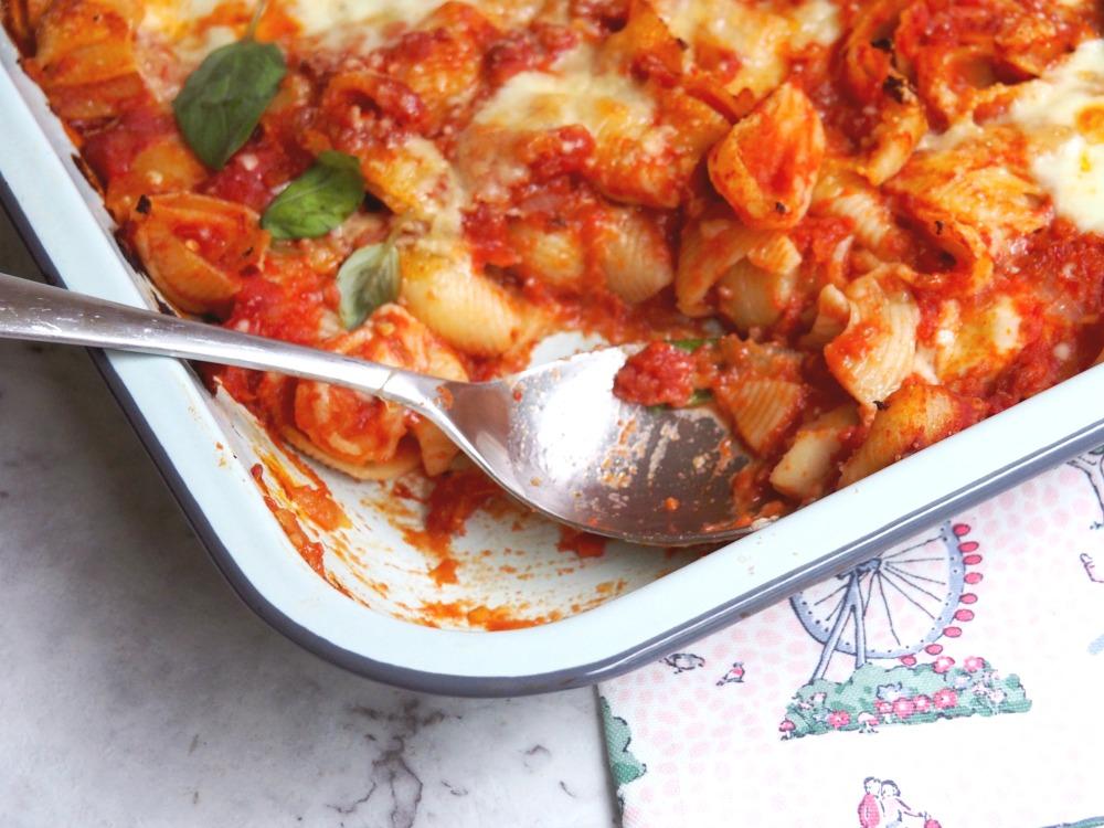 tomato mozzarella bake serving spoon