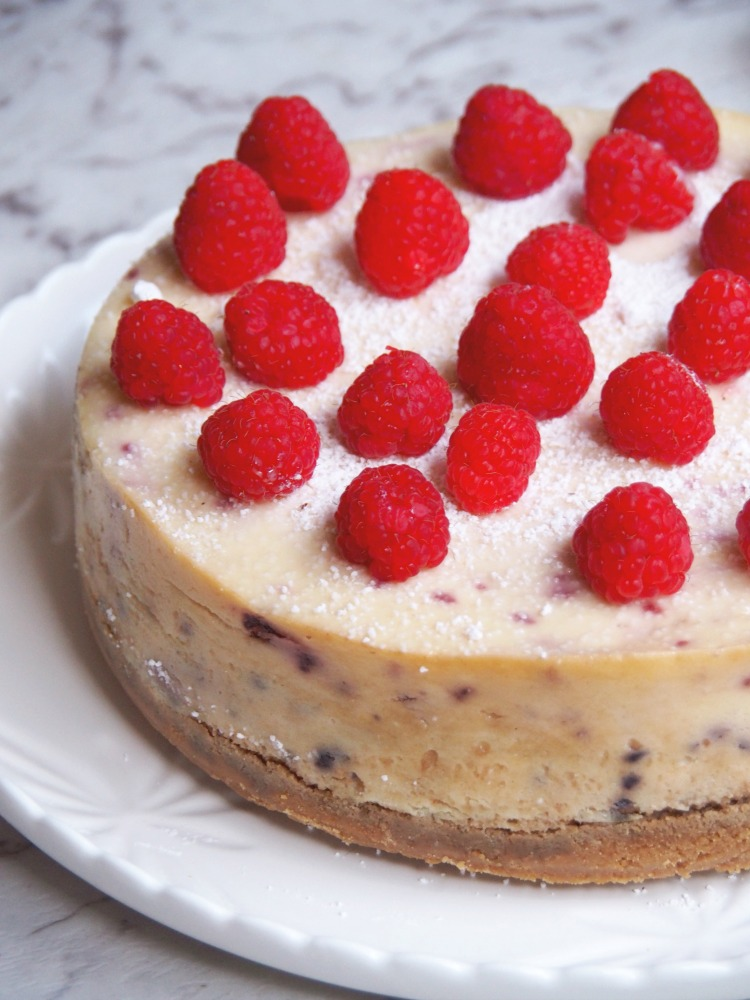 baked lemon and raspberry cheesecake side view left