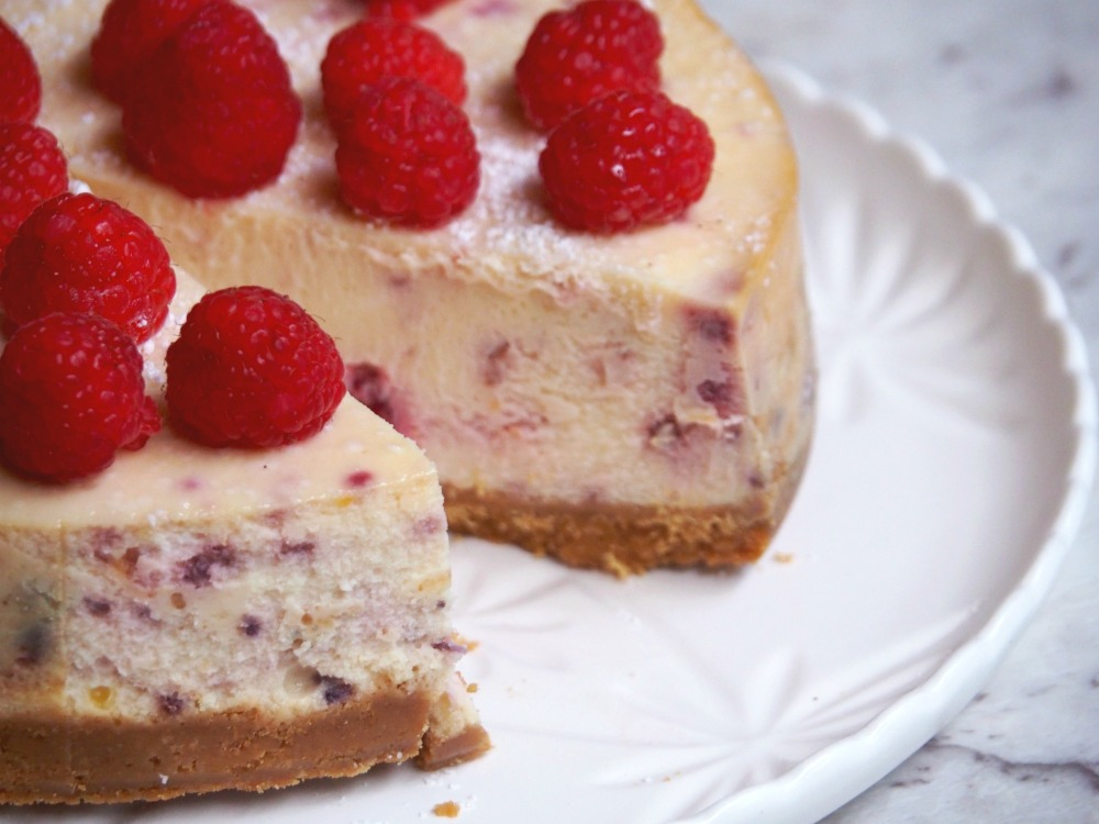 baked lemon and raspberry cheesecake cut