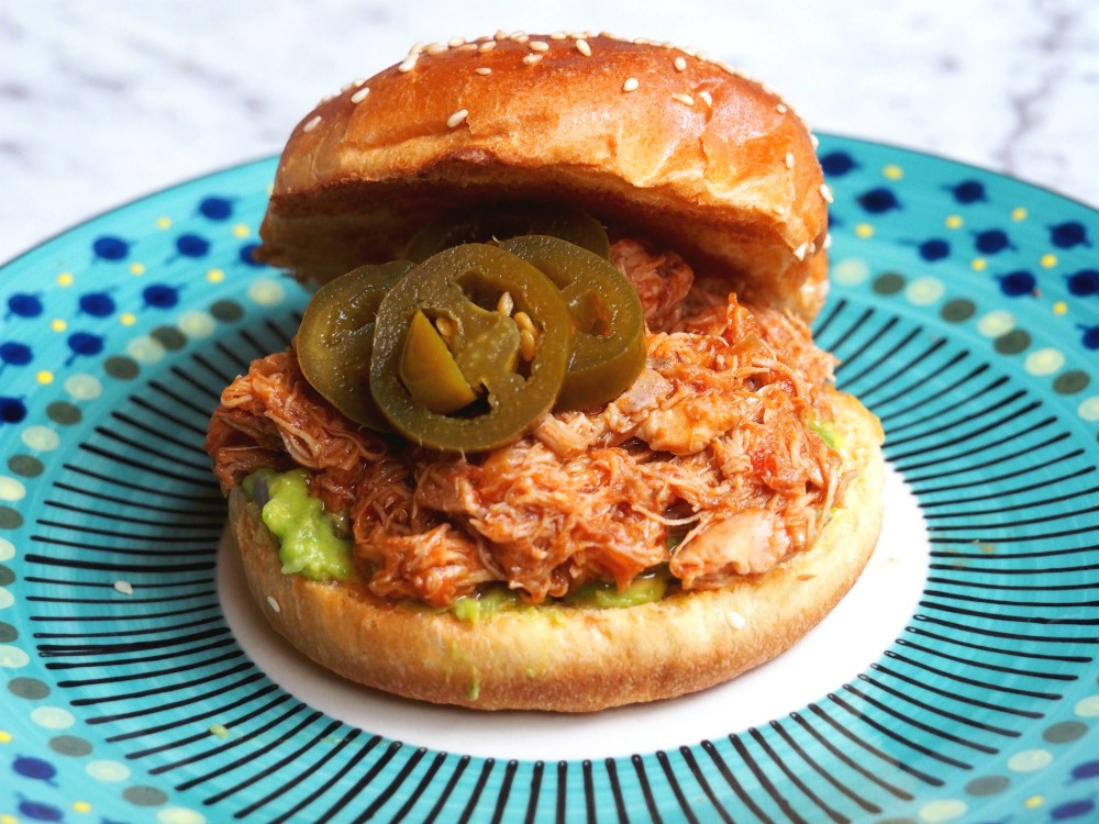 slow cooker pulled chicken served in a bun