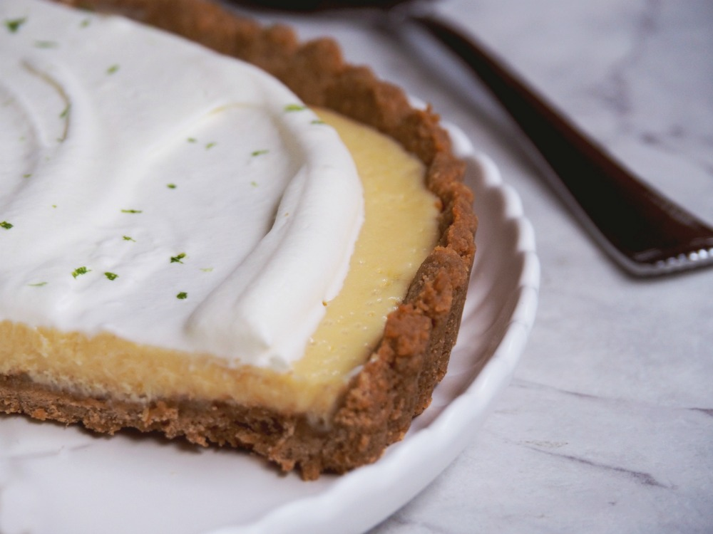 key lime pie with slice cut out