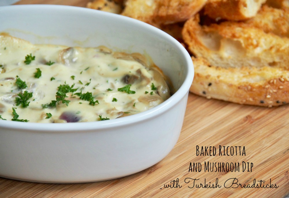baked ricotta and mushroom dip with turkish breadsticks on side