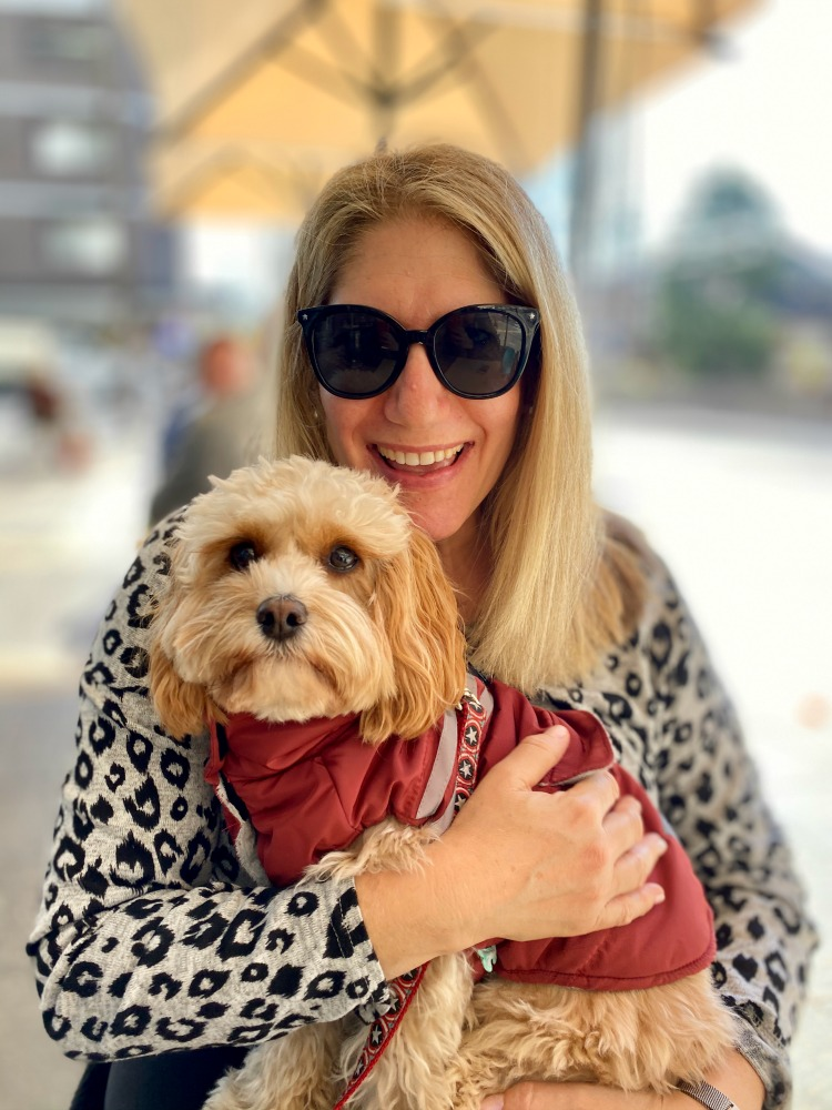 woman holding cavoodle