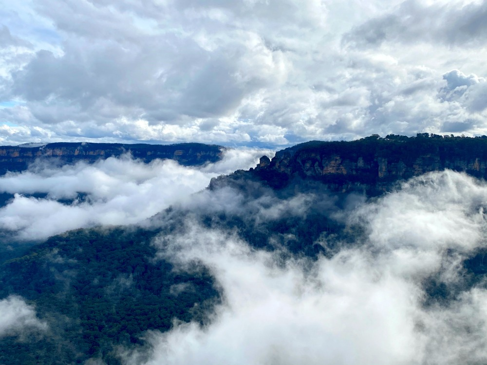 blue mountains under cloud cover