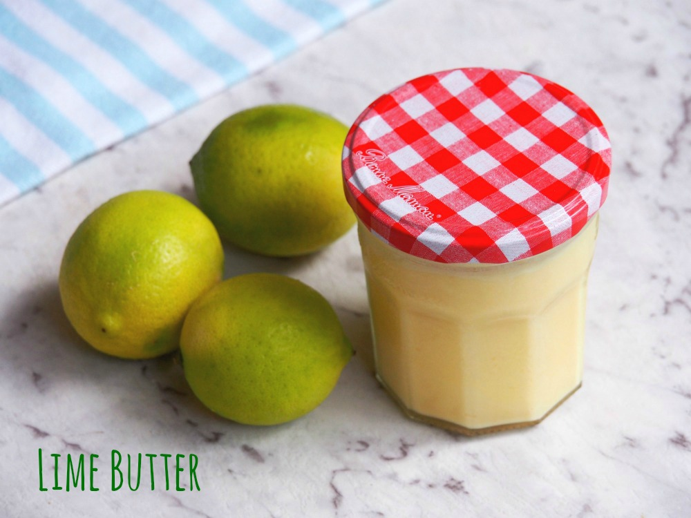 jar of lime butter with some limes