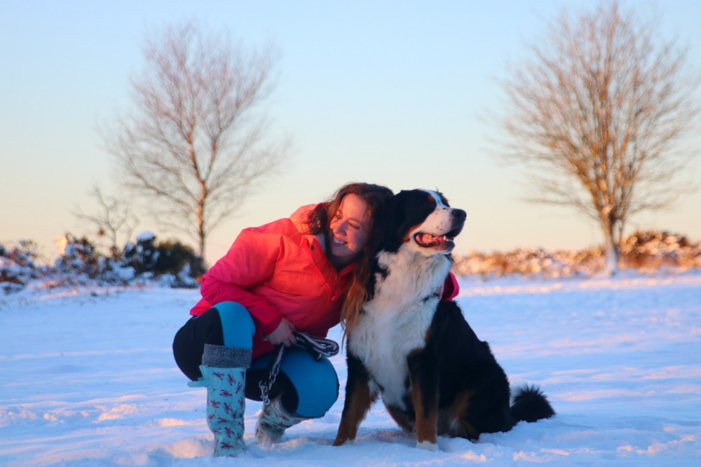 Lisa Dickenson in the snow with her dog