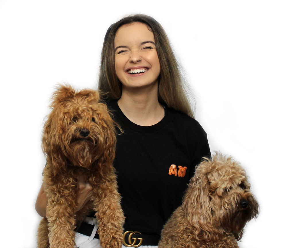 Breeze from zoopeez holding two dogs