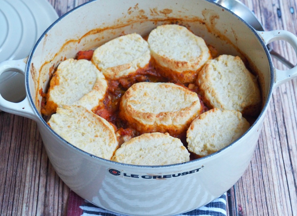 harissa vegetable stew with cheddar dumplings in pot