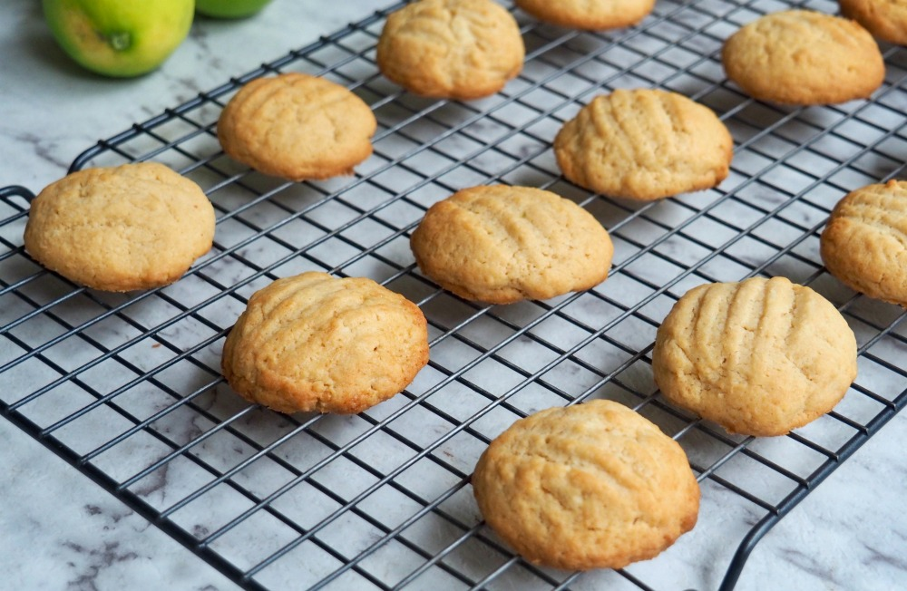 lime coconut cream cheese cookies on cooling rack