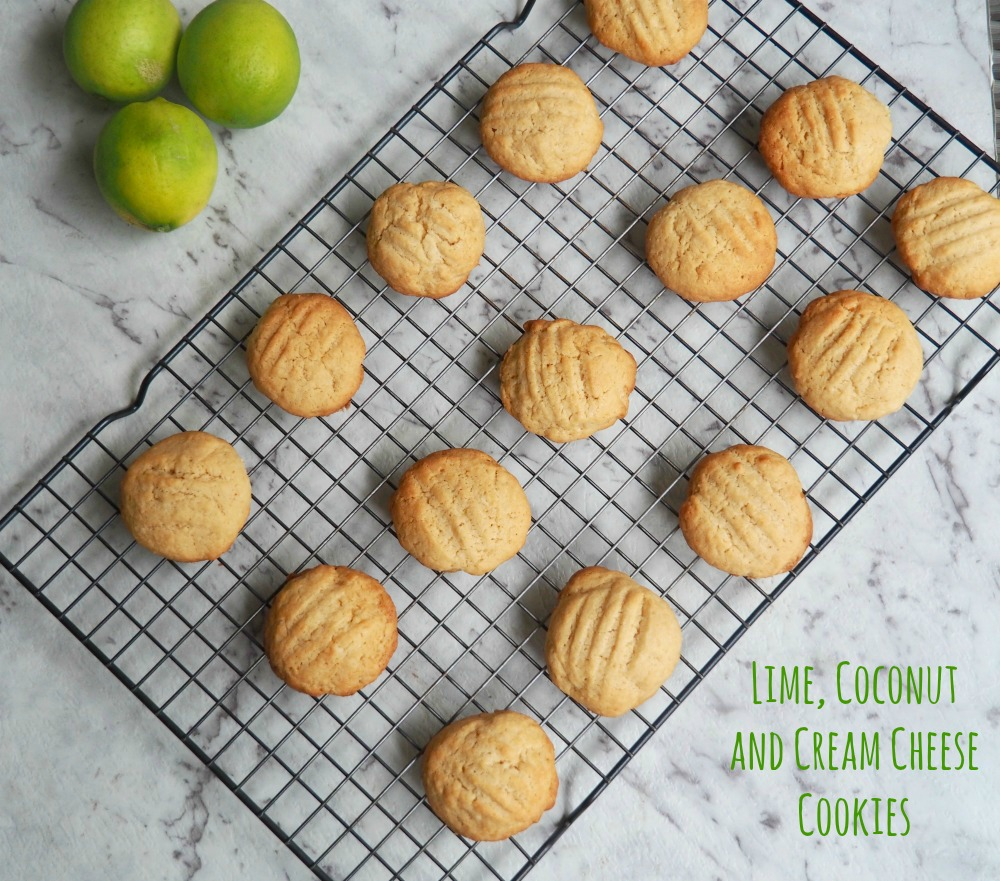 lime coconut cream cheese cookies with limes in background