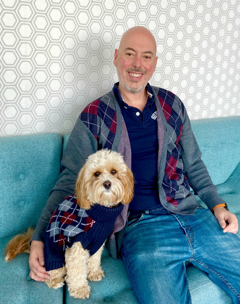 man and cavoodle wearing matching knitwear