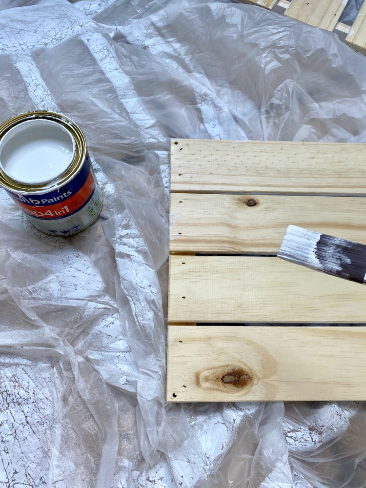 wooden box paintbrush and primer
