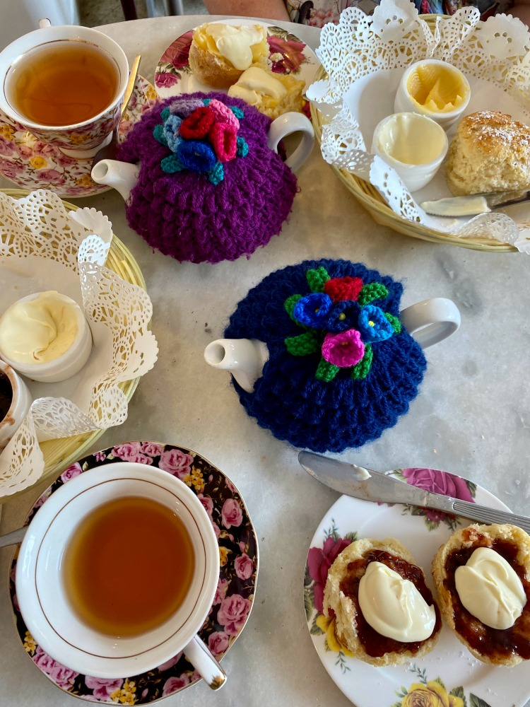 teapot teacups and scones on a table