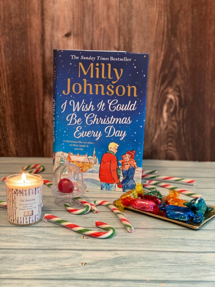 christmas novel surrounded by candy canes and candles