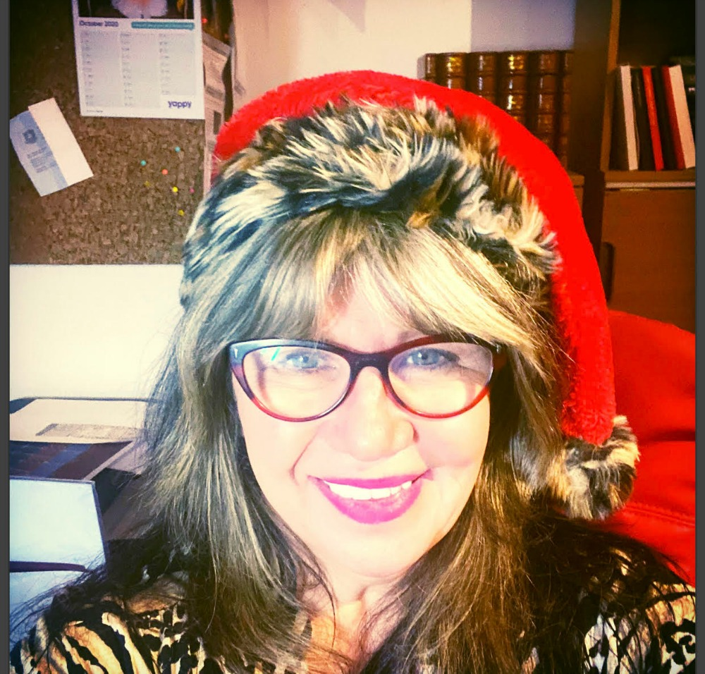 woman wearing glasses and a Santa hat