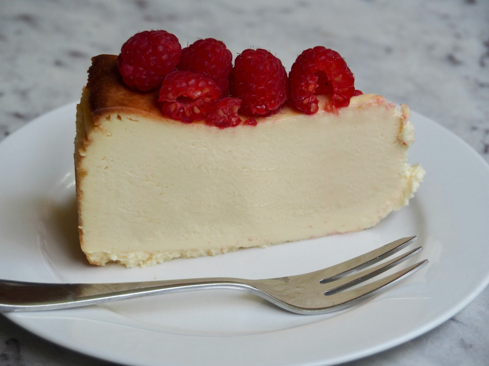 slice of crustless cheesecake topped with raspberries