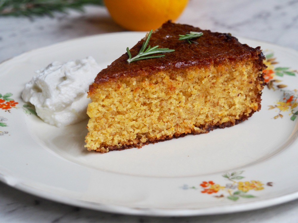 slice of gluten free orange cake with rosemary