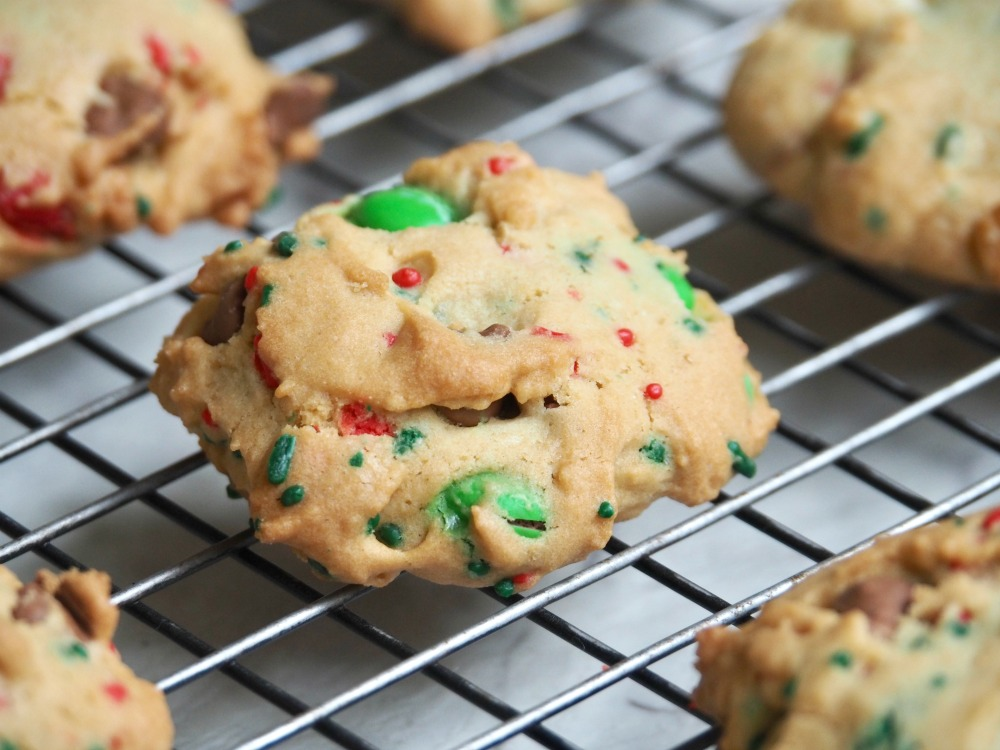 fully loaded christmas choc chip m and m cookies on cooling rack