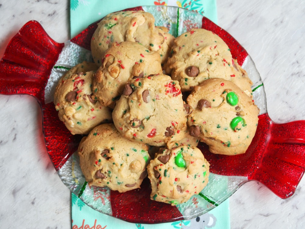 looking down on a plate of fully loaded choc chip and m and m christmas cookies