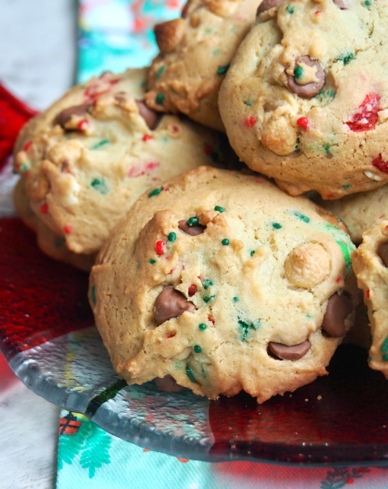 plate of fully loaded christmas choc chip and m and m cookies