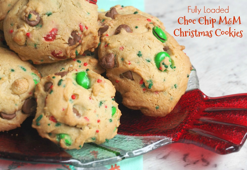 plate of fully loaded christmas choc chip m and m cookies