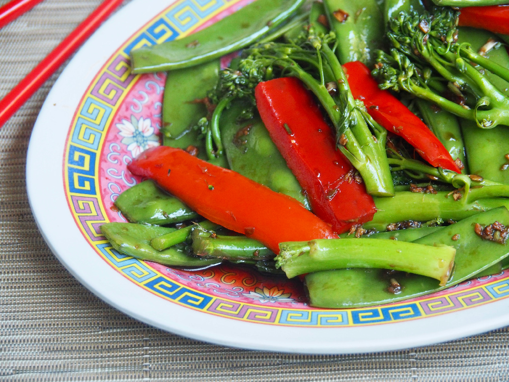 steamed asian veggies with chopsticks