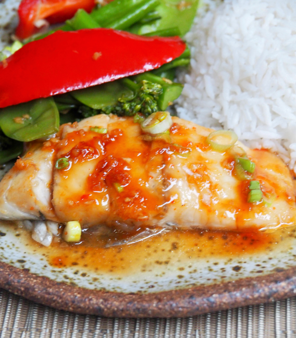 soy and sweet chilli fish with steamed rice and Asian greens
