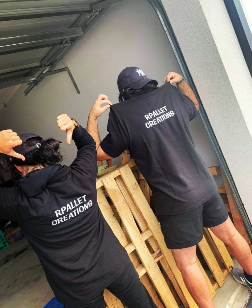 man and woman wearing hoodies saying rpallet creations