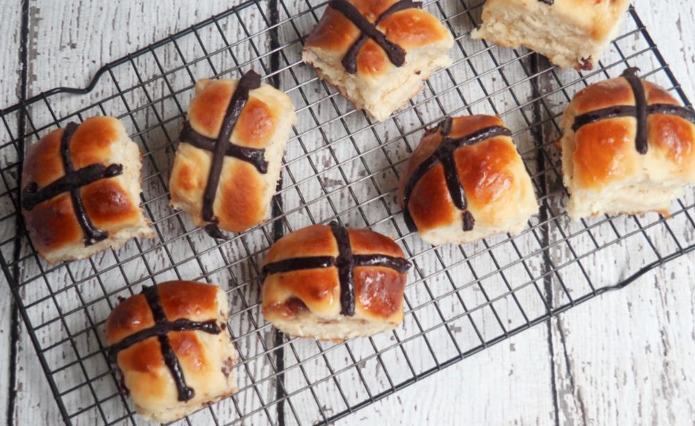 choc fudge hot cross buns on cooling rack