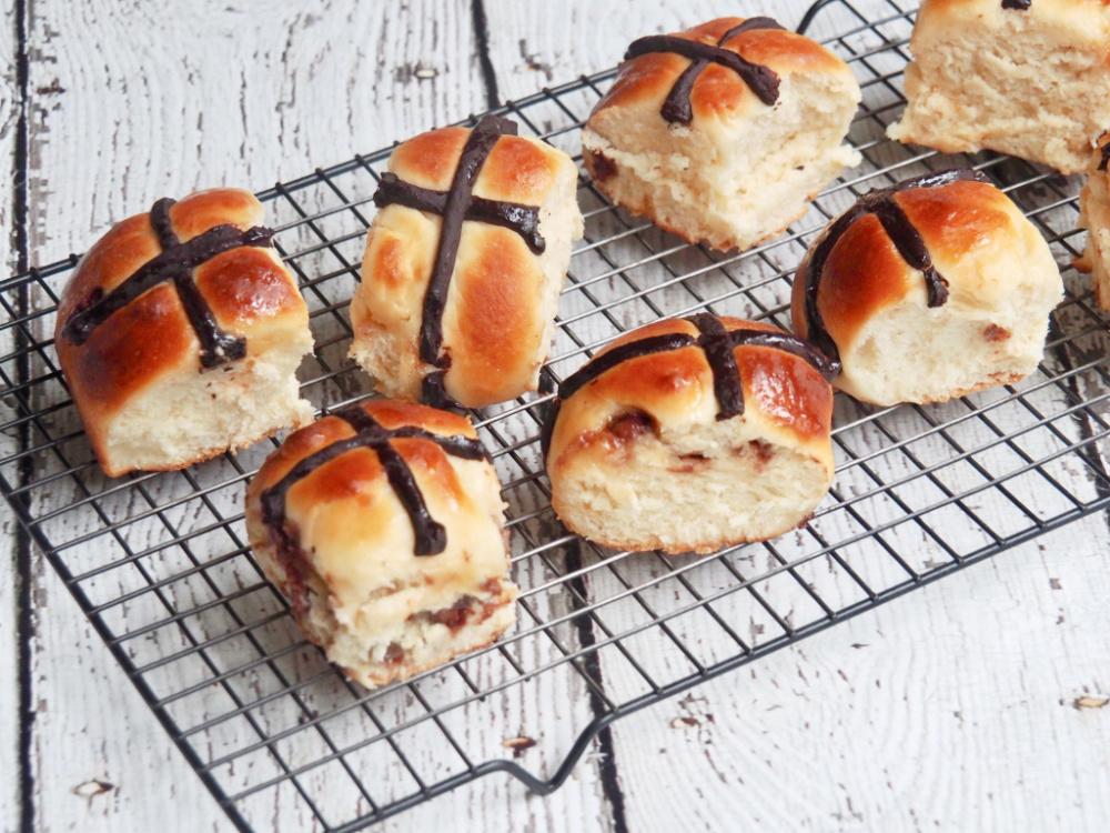 choc chip hot cross buns on cooling rack