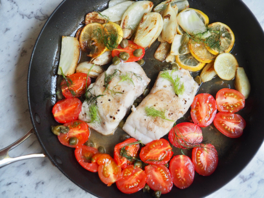lemon fish with fennel and capers in a pan