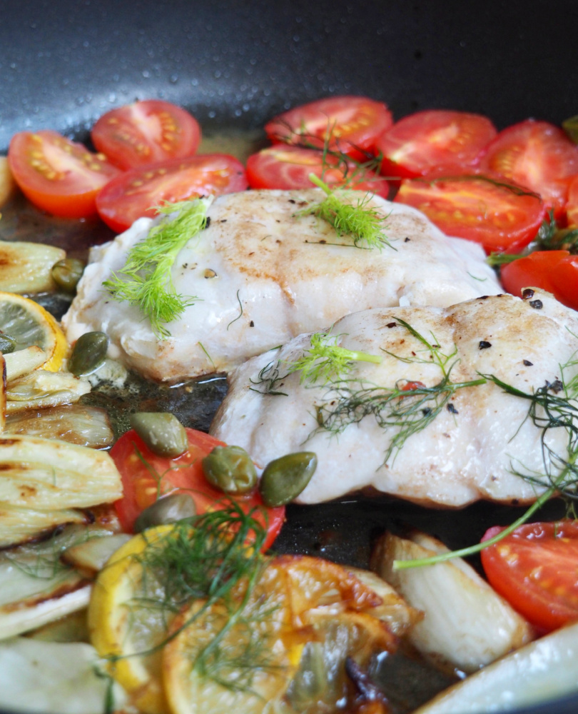 lemon fish with fennel and capers in pan