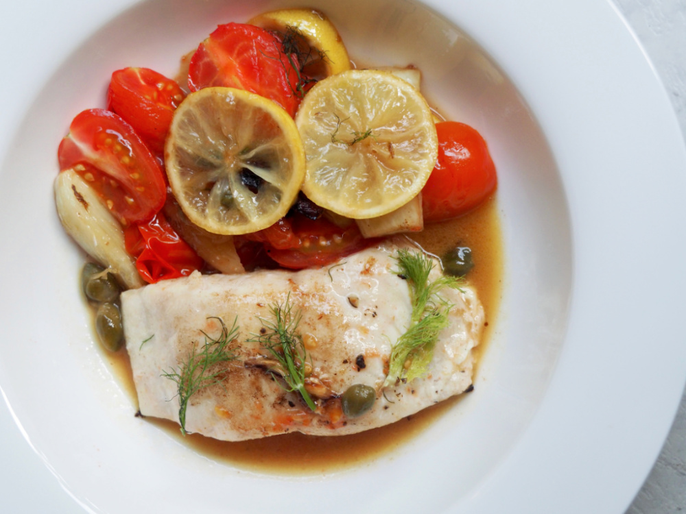 lemon fish with fennel and capers on a plate