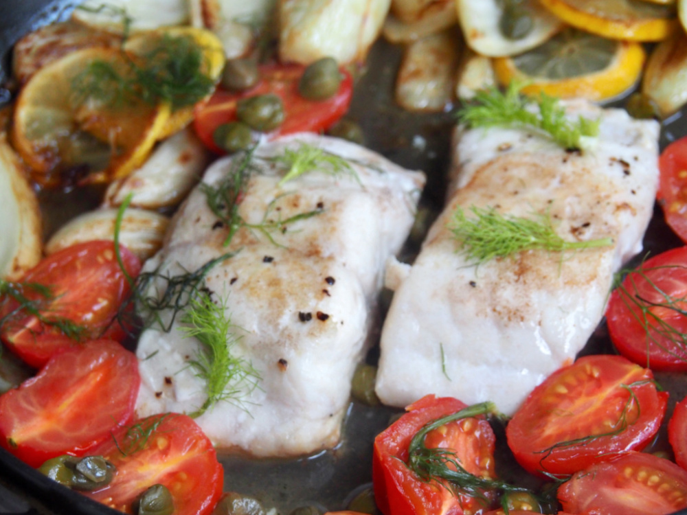 close up of lemon fish with fennel and capers