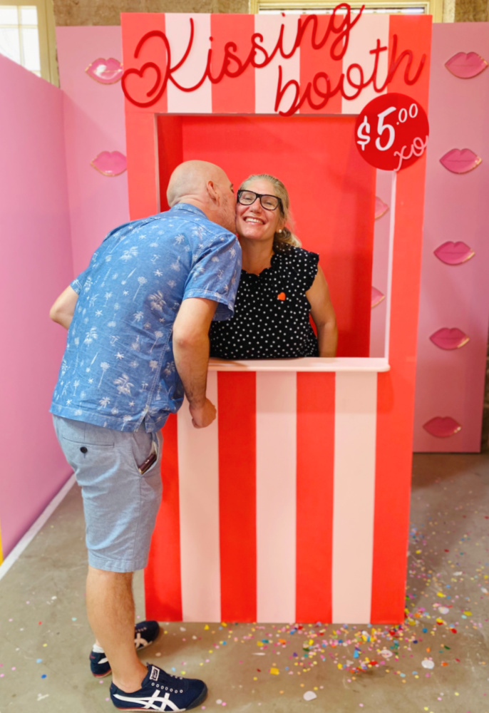 couple kissing in kissing booth