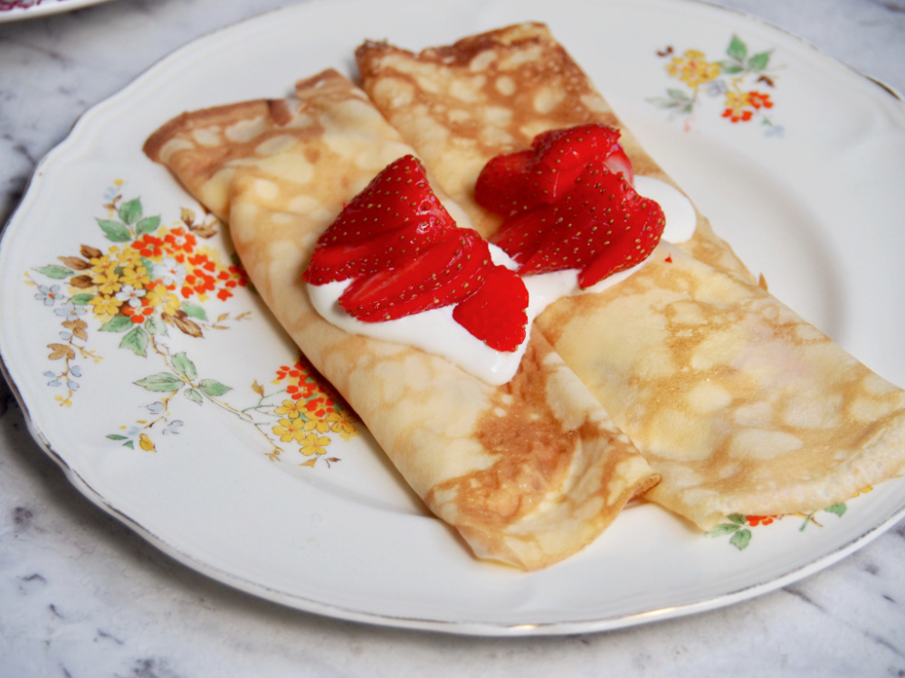 strawberry sour cream crepes on plate