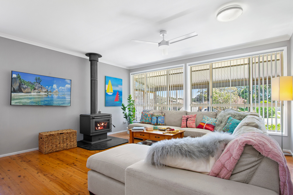 living room with cosy sofas and throws