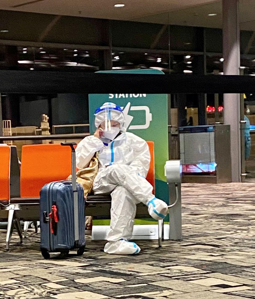 an airline passenger wearing full PPE