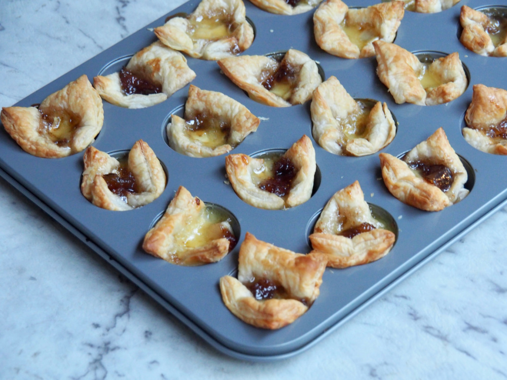 mini muffin tray with fig jam and brie bites