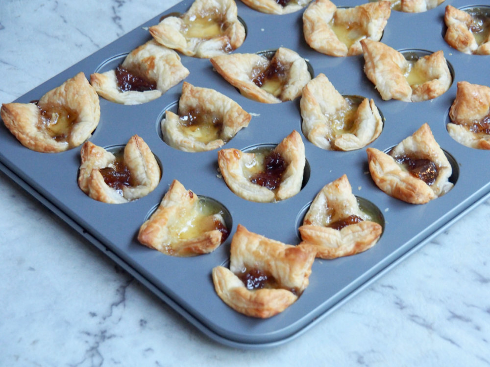 fig jam and brie bites in mini muffin tray