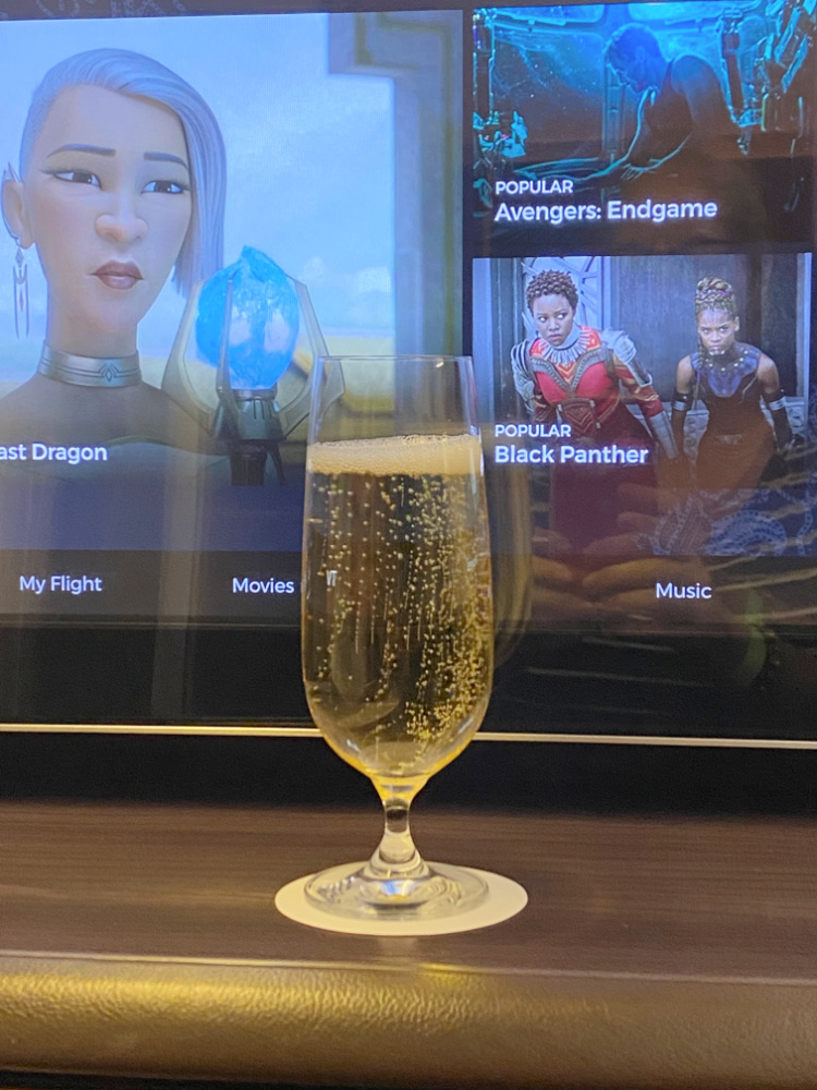 Glass of champagne in Singapore airlines first class