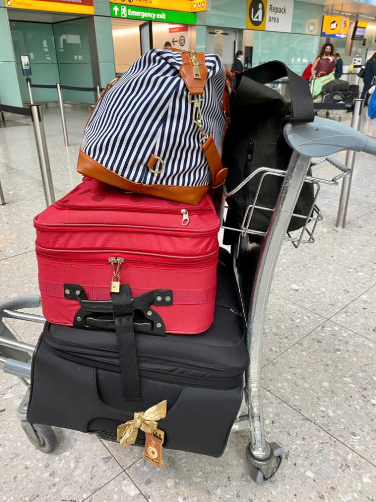 luggage trolley full of bags