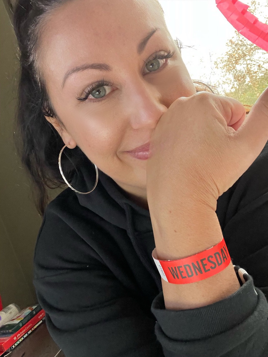 selfie of woman in hotel quarantine wearing release wrist band