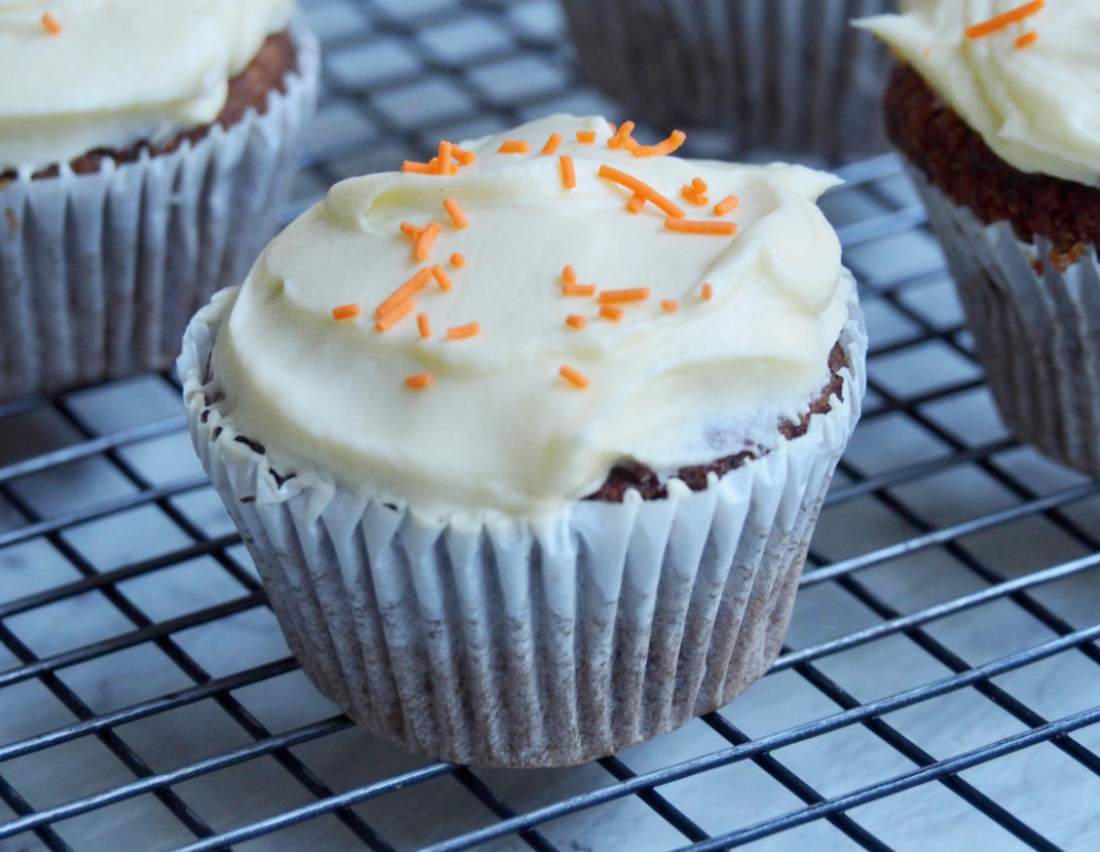 carrot cupcake on wire rack close up