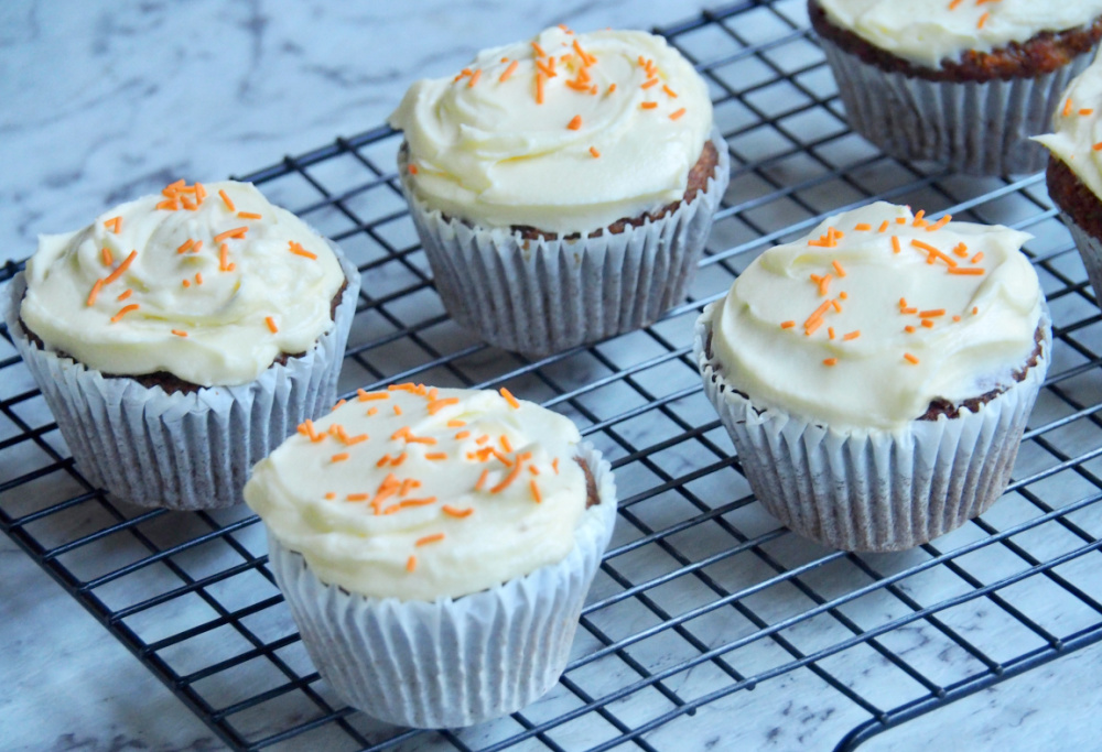 carrot cake cupcakes on a wire rack