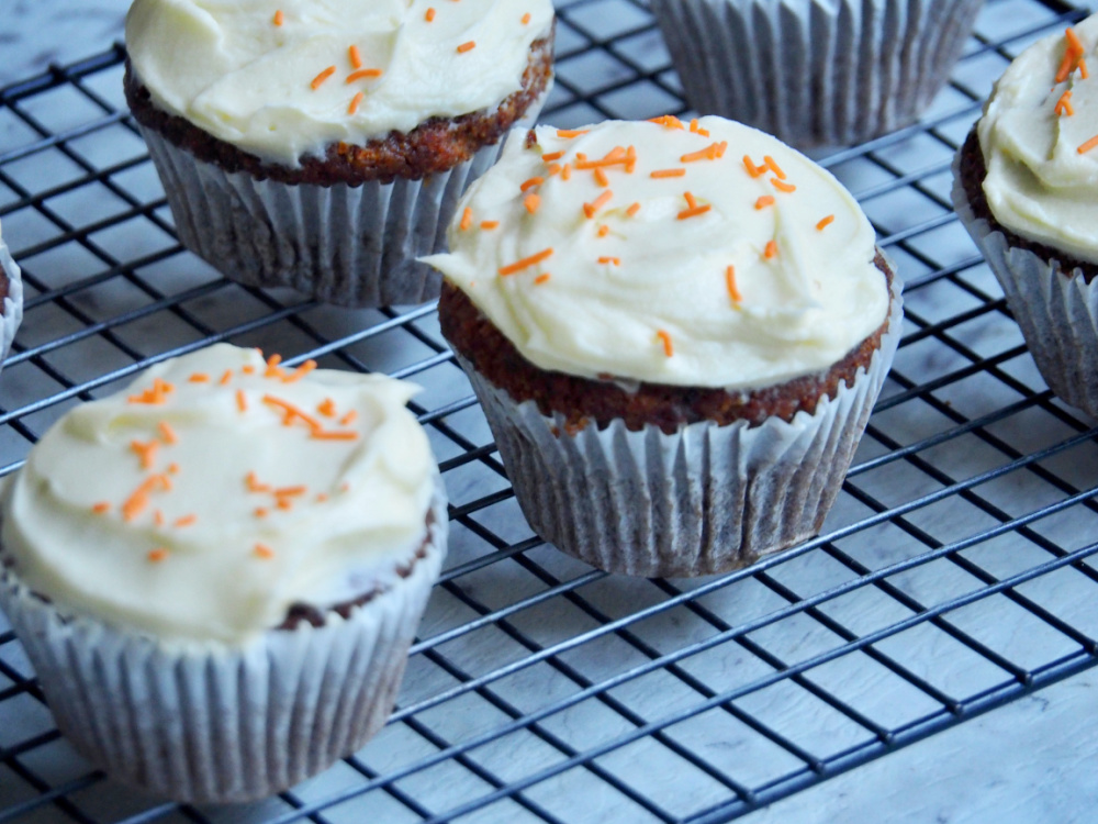 carrot cake cupcakes on cooling rack