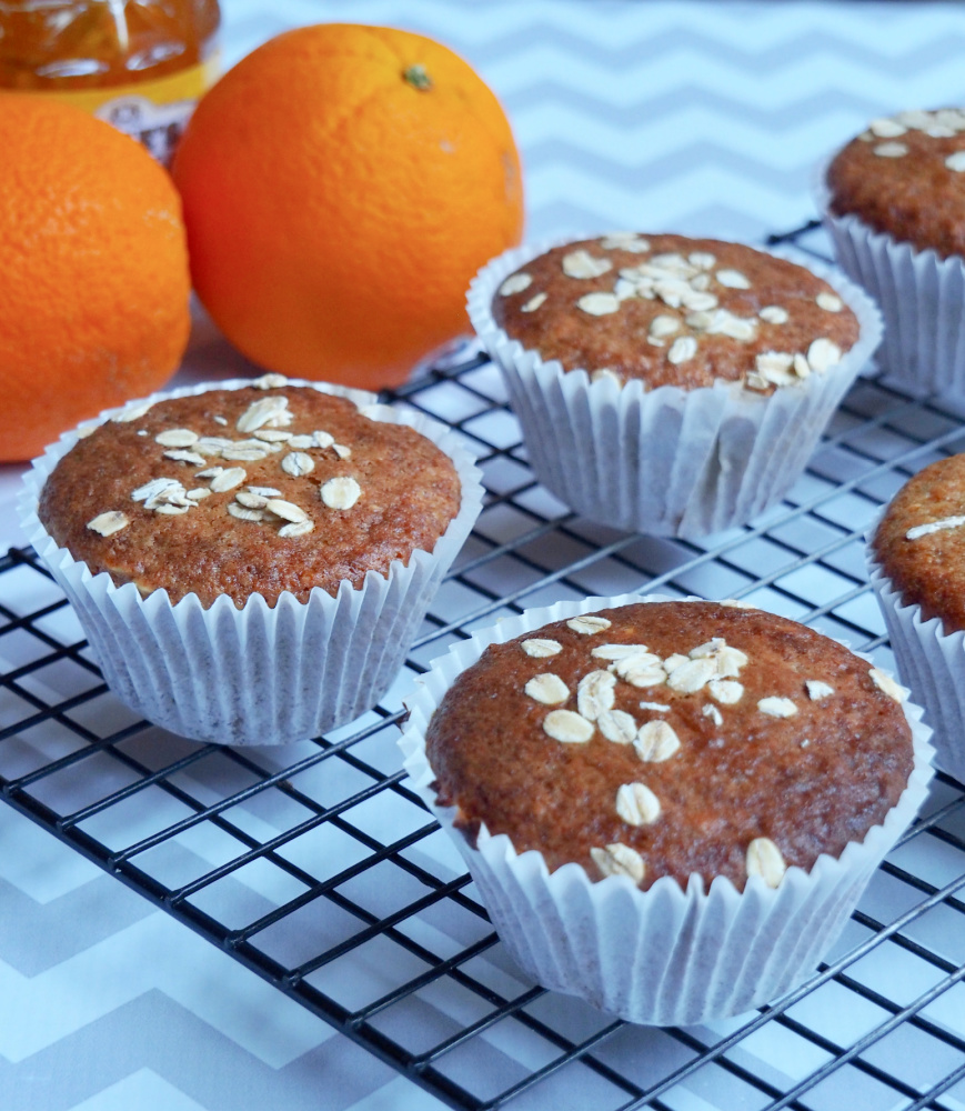 marmalade muffins with oranges in background