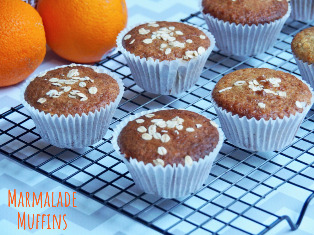 marmalade muffins with oranges in the background